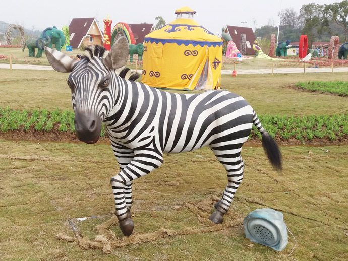 Zebra model in the amusement park with the children